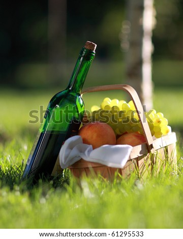 Still life with red wine and fruits - stock photo