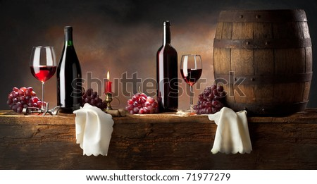 still life with red wine on old wood - stock photo