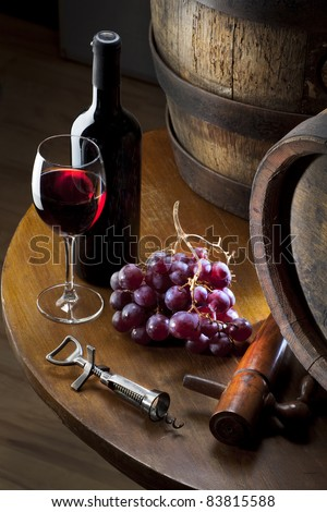 still life with red wine on table - stock photo