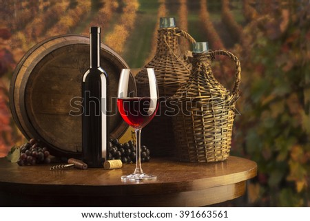 still life with red wine on vineyard background