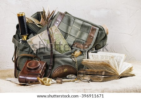 Still Life with Retro Backpack and Travel Accessories - stock photo