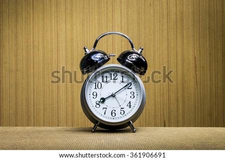 Still life with retro clock, retro alarm clock. - stock photo