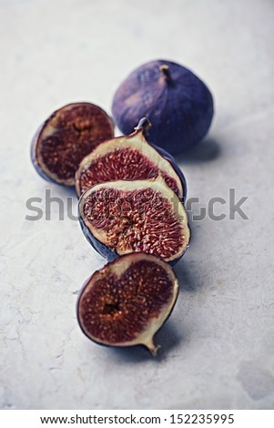 Still life with ripe figs on marble  - stock photo