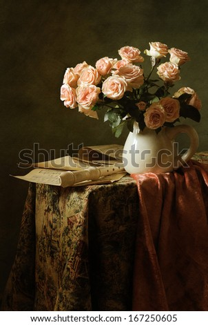 Still life with roses and a flute - stock photo