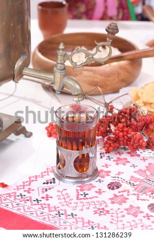 Still-life with Russian samovar, sweet jam, appetizing pancakes and tasty red caviar to pancake week celebrating - stock photo
