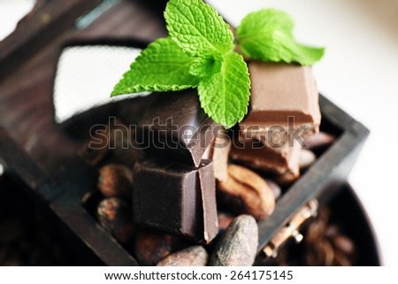 Still life with set of chocolate, nuts and coffee grains, closeup - stock photo
