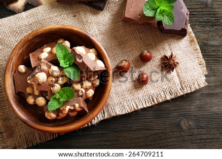 Still life with set of chocolate on table, top view - stock photo