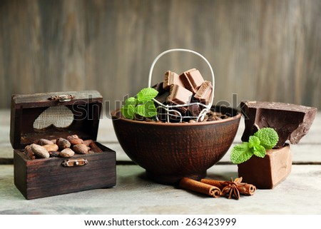 Still life with set of chocolate on wooden background - stock photo