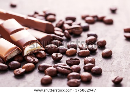 Still life with set of chocolate with coffee grains, closeup - stock photo