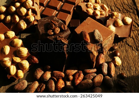 Still life with set of chocolate with nuts, closeup - stock photo