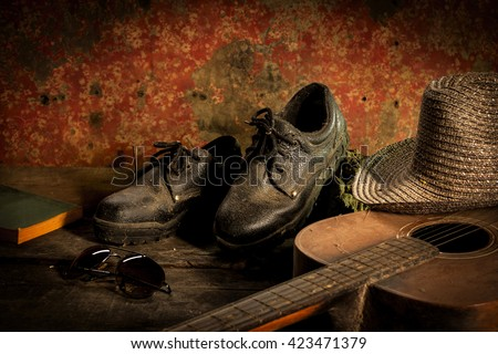 Still Life with shoes and book, hat,guitar,glasses,on wood