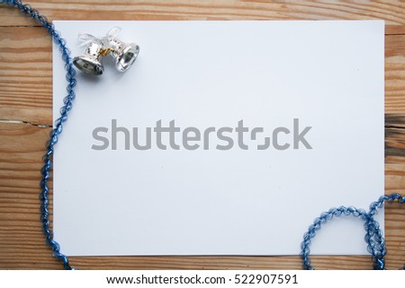 Still life with silver and white Christmas decorations and a blank card