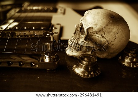 Still life with skull and electric guitar - stock photo