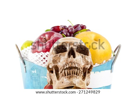 still life with skull and fruits on a white background. - stock photo