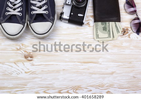 still life with sneakers, camera, sunglasses and wallet - stock photo