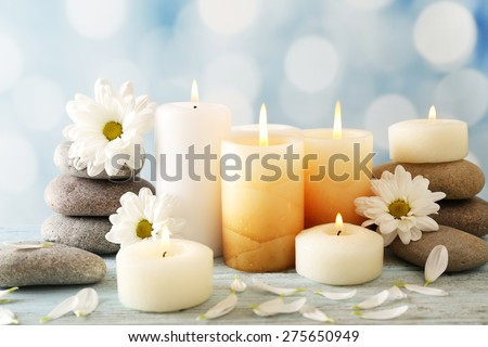 Still life with spa candles on light blurred background