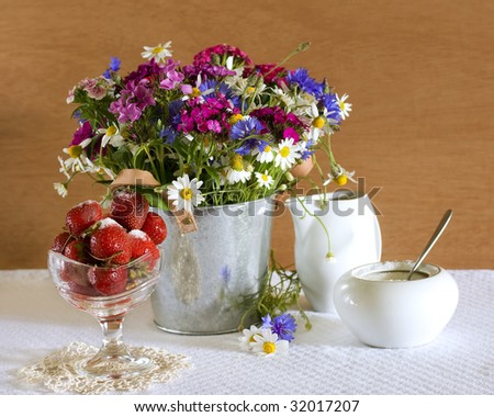 Still life with strawberries and wild flowers - stock photo