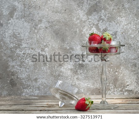 Still Life with strawberries in a glass vase - stock photo