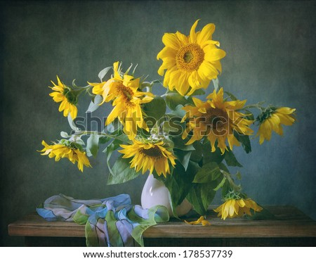 Still life with sunflowers and a shawl - stock photo