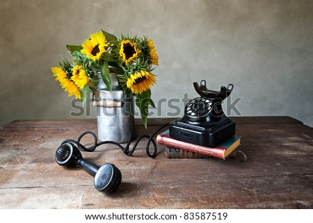 Still Life with Sunflowers and antique black Telephone