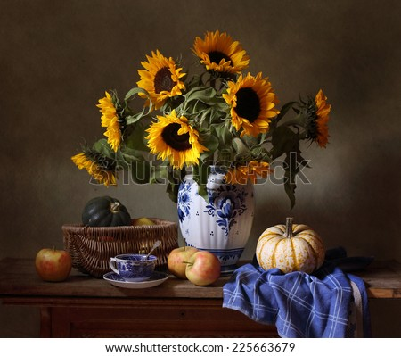 Still life with sunflowers, apples and pumpkins - stock photo