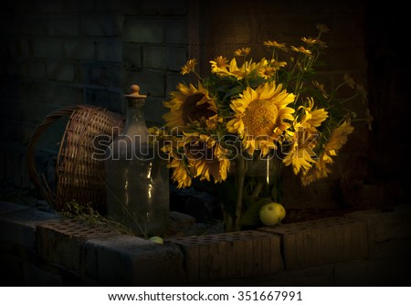 Still life with sunflowers. Photo in low key - stock photo