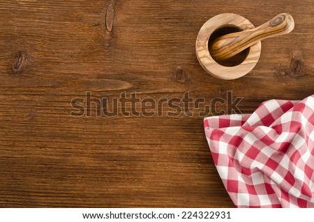 Still life with tablecloth on a wooden background   - stock photo
