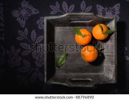 Still life with tangerines in a wooden basket - stock photo