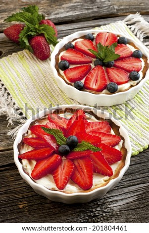 Still life with  tasty cakes and  fresh berries - stock photo