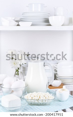 Still life with tasty dairy products on table