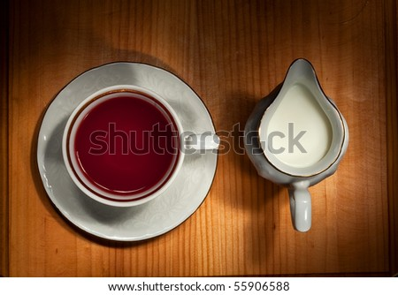 Still life with tea and milk jug - stock photo