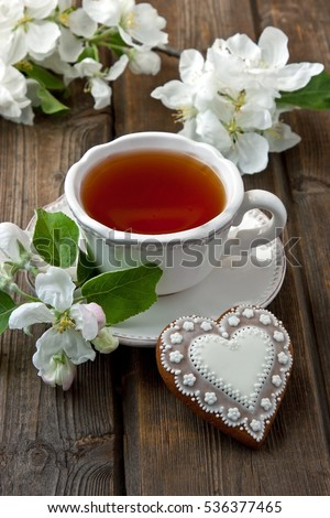 Still life with tea cup on wooden background