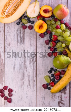 Still life with the delicious fruits lying on the wooden table - stock photo