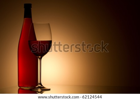 Still-life with the rose wine glass and bottle on gold