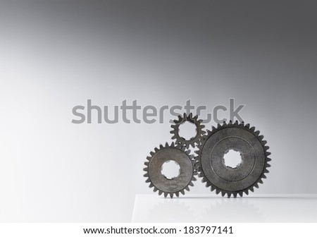 Still life with three old cog gears. Lots of copy space. - stock photo