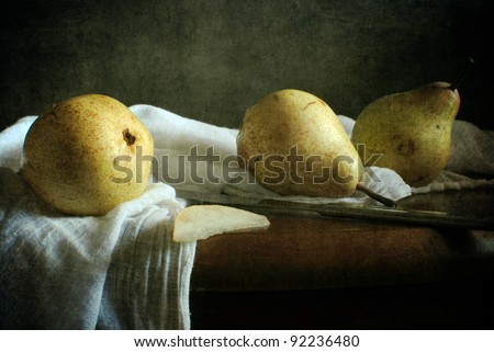 Still life with three pears - stock photo