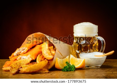 still life with traditional homemade fish, chips and beer - stock photo