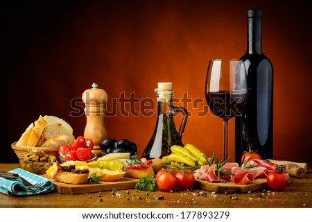 still life with traditional spanish tapas and red wine - stock photo