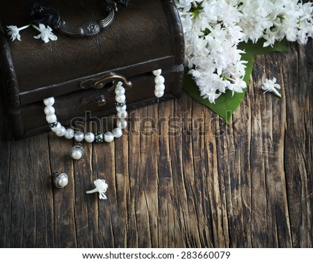 Still life with treasure chest and pearl necklaces. - stock photo