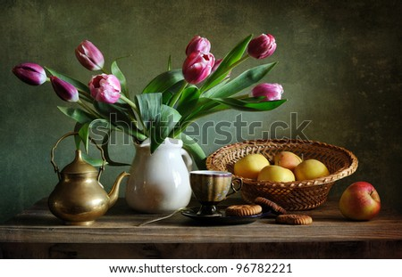 Still life with tulips and apples - stock photo