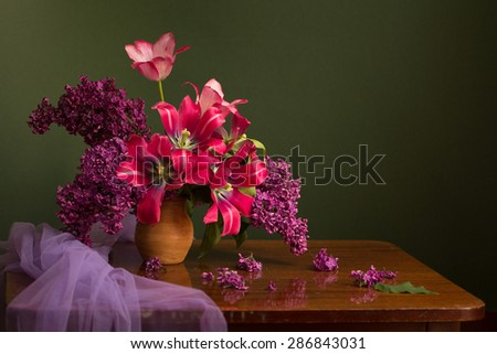 Still life with tulips in a ceramic vase - stock photo