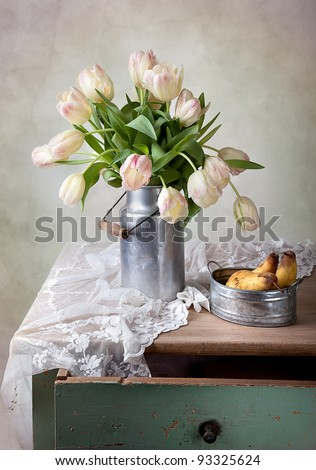 Still Life with Tulips in old milk can and Pears - stock photo