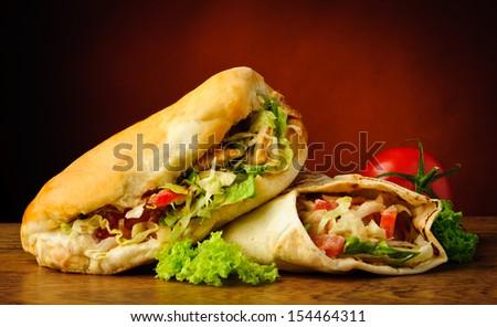 still life with turkish doner kebab and shawarma - stock photo