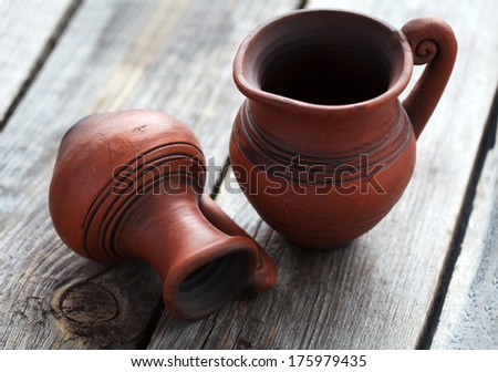 Still life with two old small jugs on a wooden table, selective focus