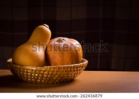 Still Life With Two Pumpkins On Dark Blured Square Background With Copy Space - stock photo