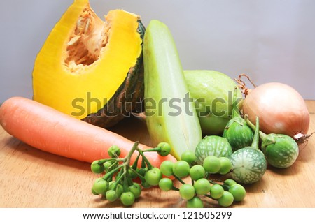 Still life with variety of vegetables on wood background - stock photo
