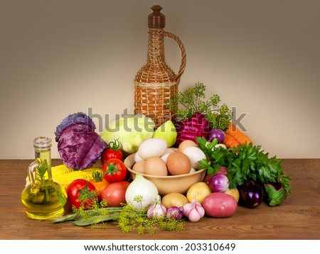 Still life with vegetables, herbs, eggs and olive oil - stock photo