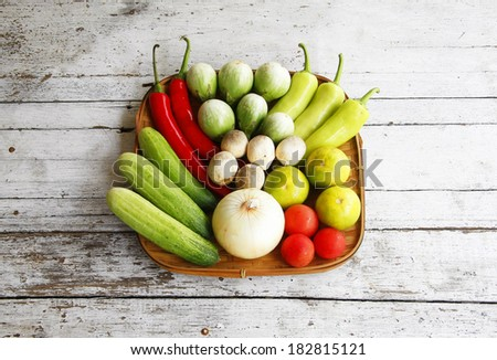 still life with vegetables on a wooden ,eggplant,pepper, cucumber,tomato and onions.  - stock photo