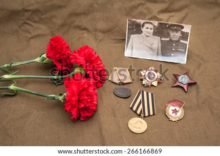 Still life with vintage objects dedicated to Victory Day. Medals and orders of Great Patriotic war. - stock photo