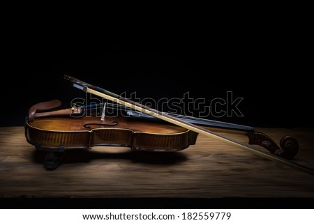 Still life with vintage violin and bow - stock photo